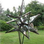 "Moravian Star - Constructed entirely of beveled glass. Approx 6"" by 5 "". $25.00"